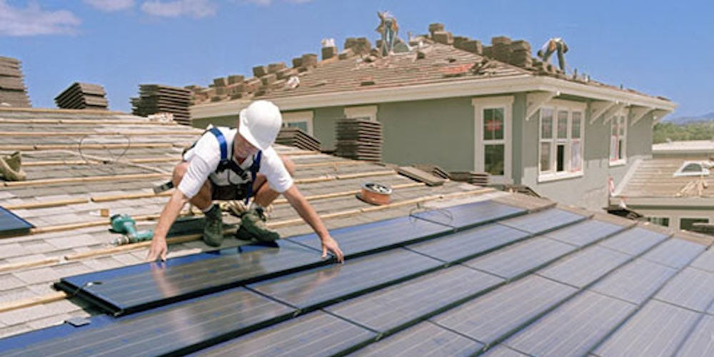 Contractor installing solar tiles on a residential roof