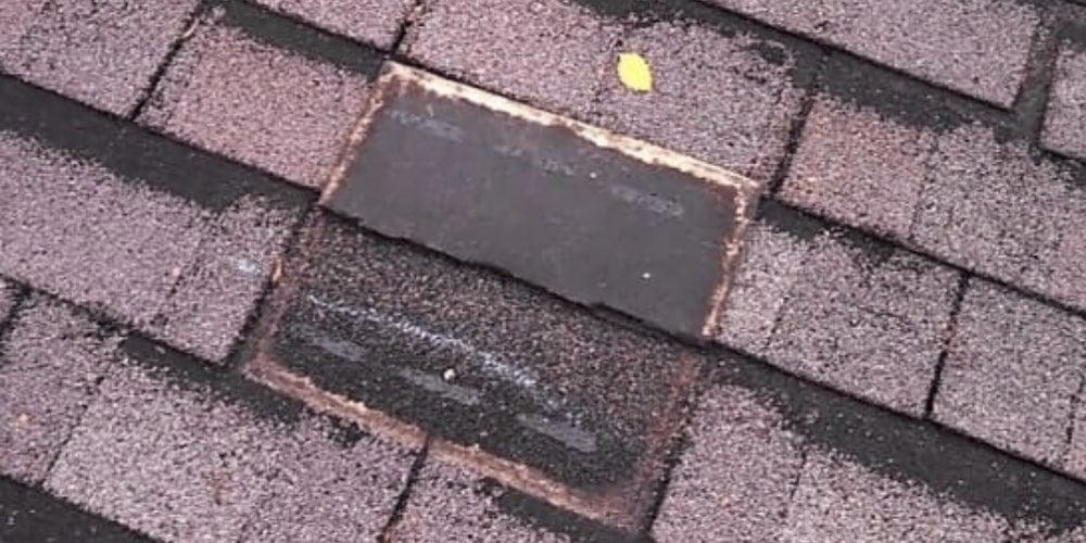 Roof shingles in disrepair