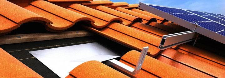 A solar roof mount under Spanish tile