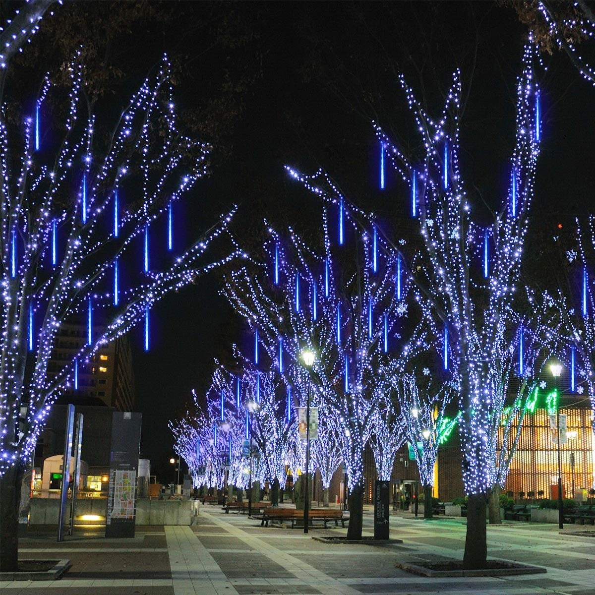 LED solar icicle tube lights covering trees