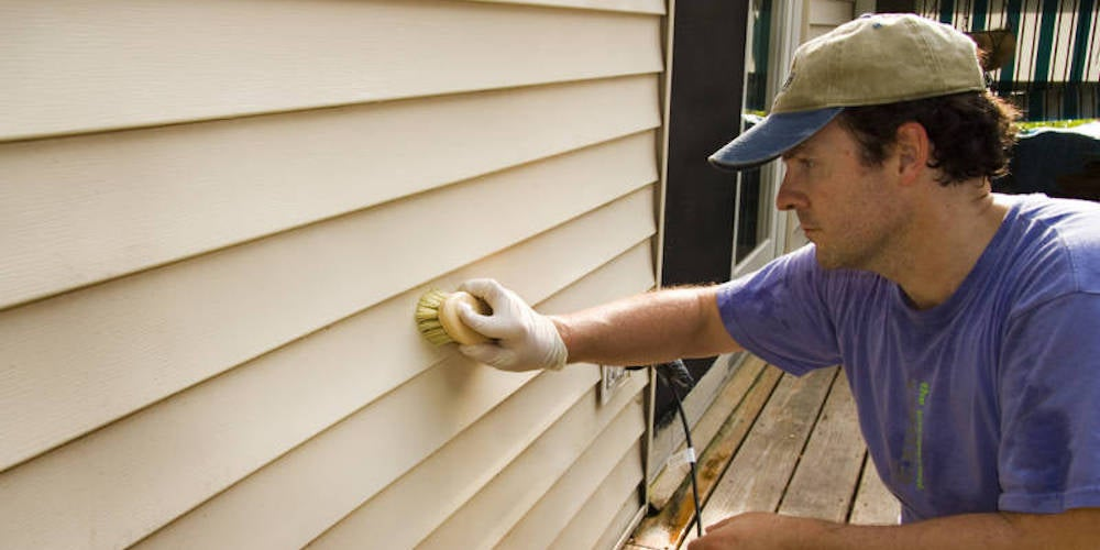 Vinyl siding being repaired