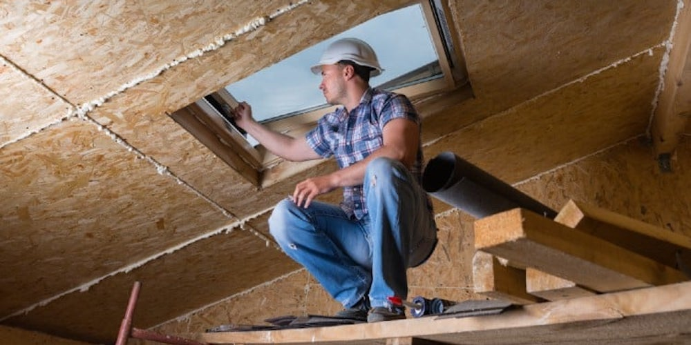 Professional installing a skylight into a roof