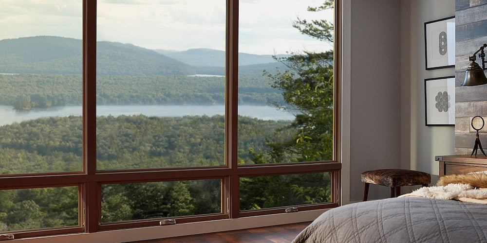 Ply Gem windows in a bedroom overlooking a lake