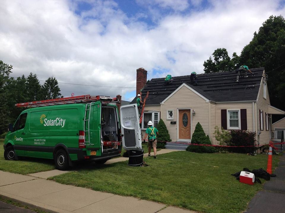 SolarCity employees installing solar on a home. Courtesy SolarCity's Facebook page.