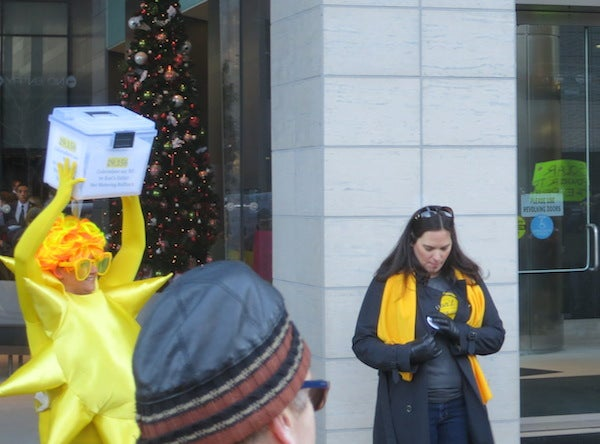 Delivering petitions to Xcel