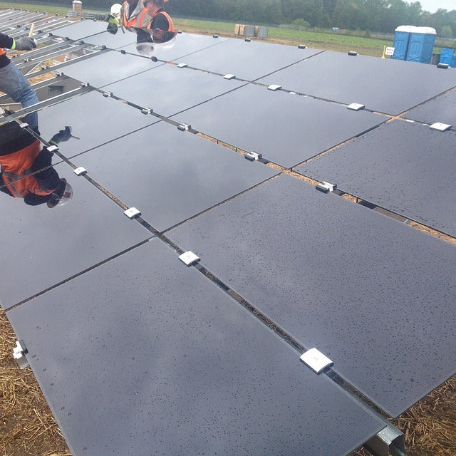 Solar panels being installed at a Duke Energy site. Courtesy Duke Energy