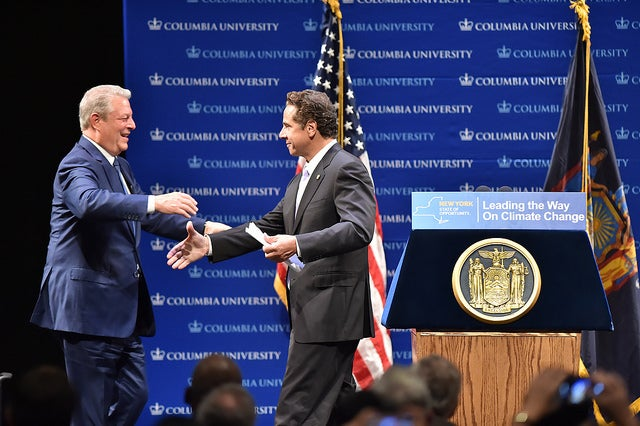 Cuomo and Gore share the stage at carbon emissions reduction signing. Courtesy Cuomo's office.