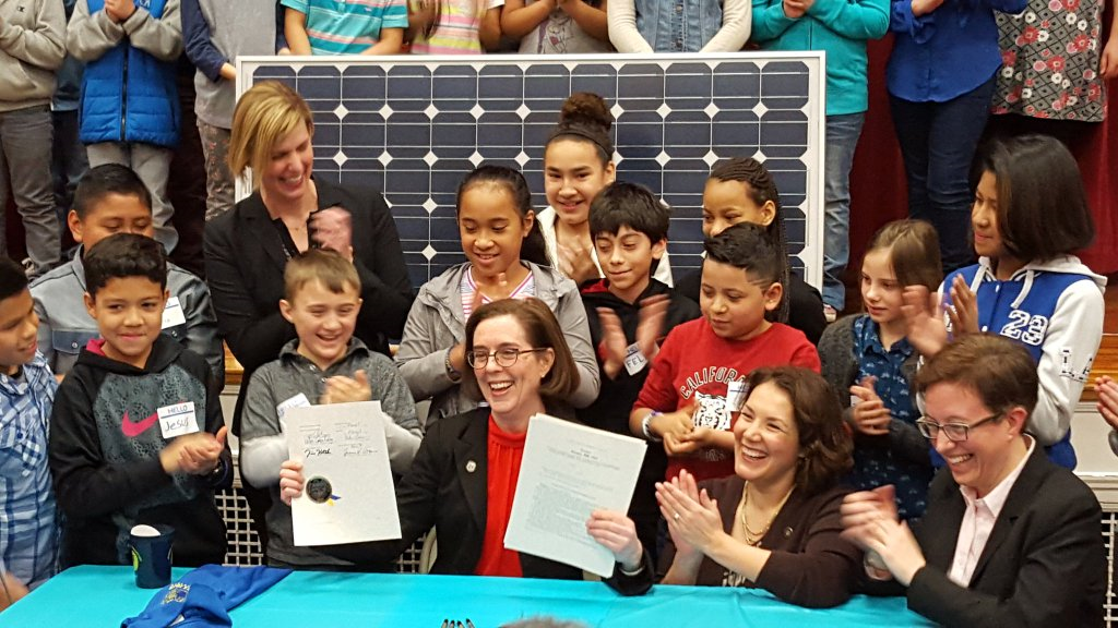 Gov. Brown signs renewables bill into law. Courtesy NRDC