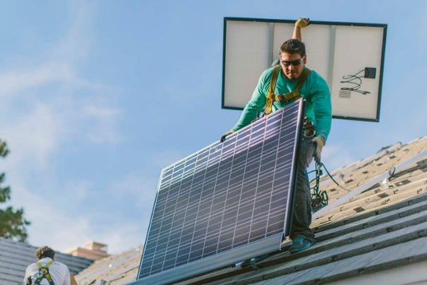 A SolarCity installer. Courtesy SolarCity's blog
