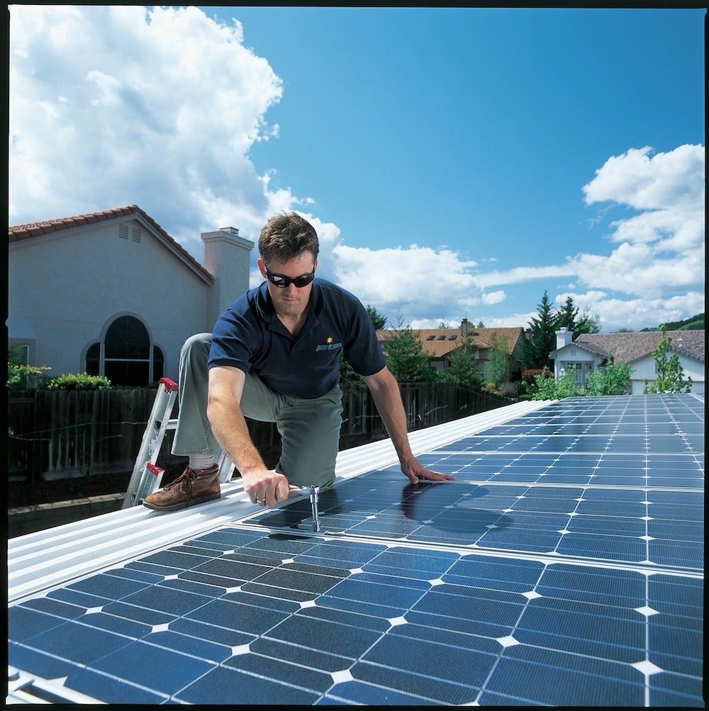 Installing solar on a rooftop. Courtesy NREL