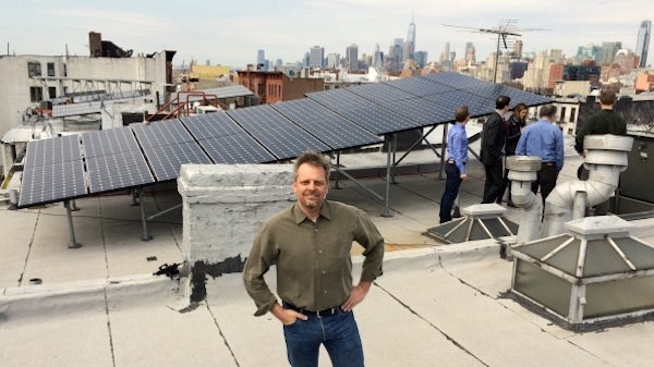 LO3 Energy founder at a microgrid. Courtesy LO3