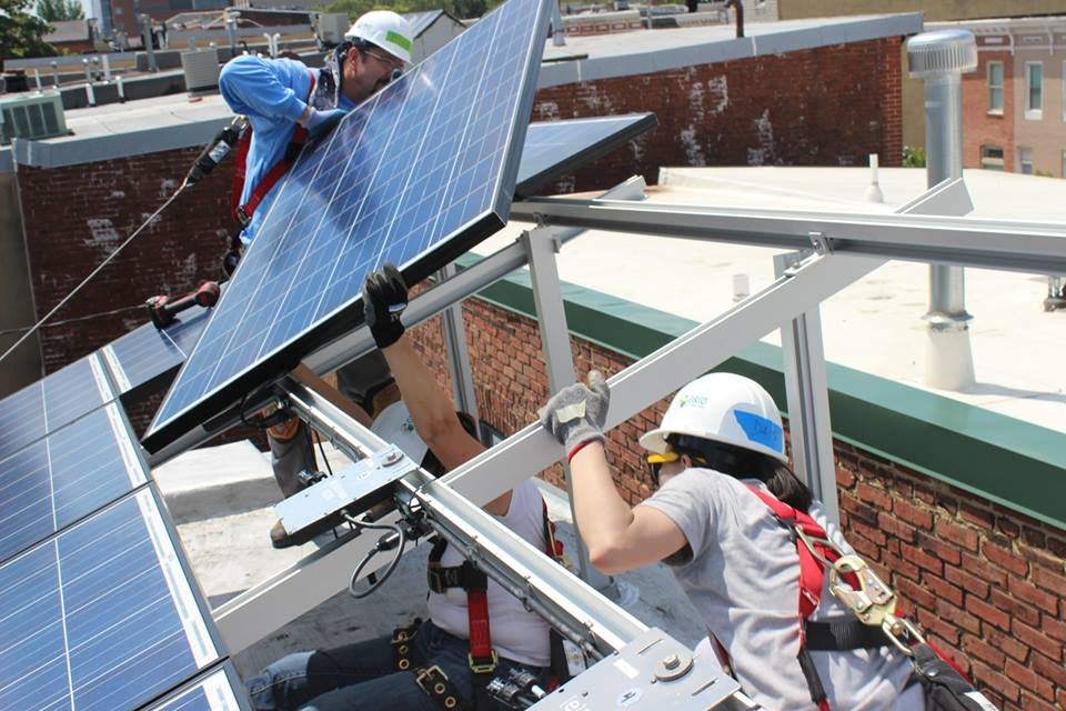 Workers installing solar panels. Courtesy SEPA's Facebook page