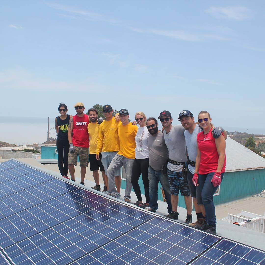 The Sol Collective Team and Solar Array in Tijuana, Mexico. Courtsey of the Sol Collective.