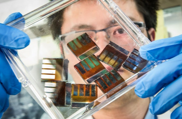 Researchers at NREL testing Perovskite crystals. Courtesy NREL